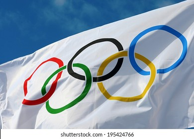 ATHENS, GREECE- OCTOBER 2, 2013: White Olympics Flag against the blue sky in Athens, Greece.