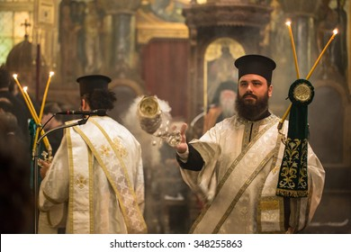 ATHENS, GREECE - OCTOBER 2, 2015: Mass in greek orthodox church in Athens, Greece