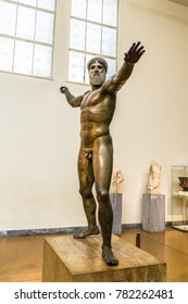 Athens, Greece/ October 2017: Bronze statue of Zeus or Poseidon in archaeological museum in Athens