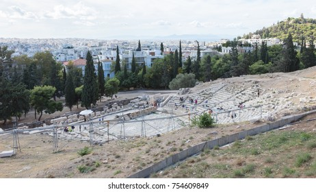 Athens, Greece - October 24, 2017: Panoramic view from the south slope of the Acropolis of Athens with the Theater of Dionysus Eleuthereus in the foreground and the city of Athens in the background.