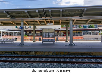 Athens, Greece - October 26 2017: Athens main railway TrainOSE station Larissa Station. Day view of Stathmos Larisis railway platforms with waiting seats, Athina sign and background station building.
