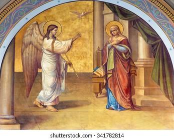 ATHENS, GREECE - OCTOBER 8, 2015: The fresco of Annunciation on the facade of Metropolitan Cathedaral by B. Antoniasis (1895)
