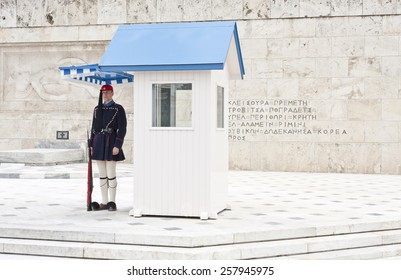 ATHENS, GREECE ON APRIL 15. Guard on duty outside the Parliament building at Syntagma on April 15, 2011 in Athens, Greece. Inscription and artwork on the wall behind.
