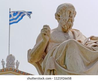 Athens Greece, Plato the famous ancient greek philosopher and a greek flag blurred in the background