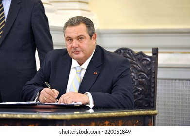 """Athens Greece Sept. 23 2015. Greek Defense Minister Panos Kammenos, leader of the right-wing party called """"ANEL"""", signs a protocol."""