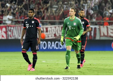 Athens, Greece- September 16, 2015: Arturo Vidal (R) Manuel Neuer (C) and Douglas Costa (L) during the UEFA Champions League game between Olympiacos and Bayern, in Athens, Greece.