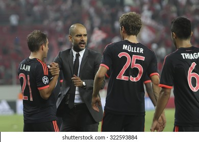 Athens, Greece- September 16, 2015: Coach Josep Guardiola celebrates with the players of Bayern Munchen during the UEFA Champions League game between Bayern and Olympiacos, in Athens, Greece.