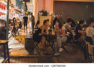 ATHENS, GREECE - SEPTEMBER 16, 2018: Athens nightlife. People chilling out at the bars after hard work day.