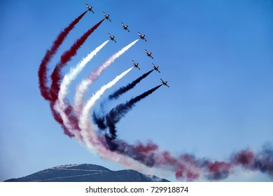 Athens, Greece - September 17, 2017: Expert pilots showing aerobatics up in the sky at the Athens air week flying show