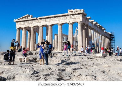 ATHENS, GREECE - SEPTEMBER 17: Tourists take photos in front of Acropolis Parthenon Temple on September 17, 2015 in Athens, Greece.