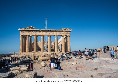 Athens, Greece  - September 21, 2018: Tourists taking pictures at Parthenon on the Acropolis in Athens, Greece