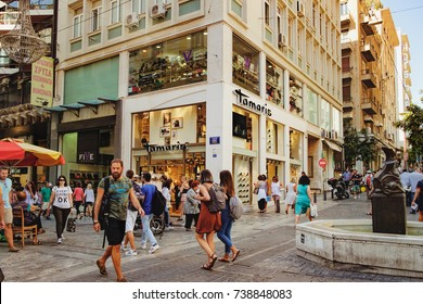 Athens, Greece - September 22, 2017: Ermou is a pedestrian only and primary clothing shopping street in downtown of Athens and contains many of the big international names. Motion blur