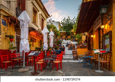 Athens, Greece - September 26, 2018: People sitting in coffee shops in a street of Plaka district in Athens, Greece.