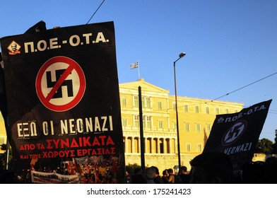 "ATHENS, GREECE - SEPTEMBER 26. A banner in Greek reading, ""out the new Nazi"" in front of the Greek Parliament during a protest against far-right Golden Dawn party, in Athens, Sept. 25, 2013."