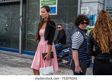 Athens - Greece, September 30, 2017. People walking, talking and waiting at Syntagma square in the city centre.