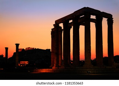ATHENS, GREECE. The Temple of Olympian Zeus (considered one of the biggest of the ancient world) after sunset, with Acropolis in the background.