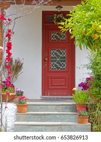 Athens Greece, vintage house entrance with flowers and plants