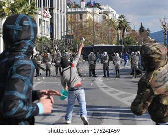 ATHENS, GREECE-DEC. 10 Young protesters casting stones to police during demonstration, in front of Greek parliament, in Athens, December 10, 2008.
