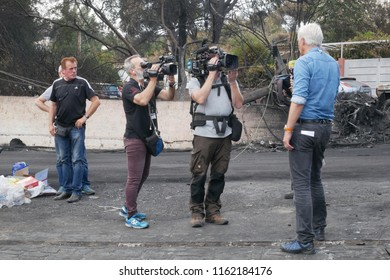 ATHENS, MATI / GREECE - JULY 25 2018: Journalist is reporting about the disaster in Mati near Athens after the fire-tragic