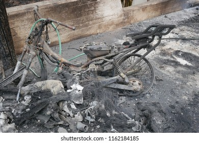 ATHENS, MATI / GREECE - JULY 25 2018: Burnt out motorcycle in a small village named Mati near Athens after the fire-tragic