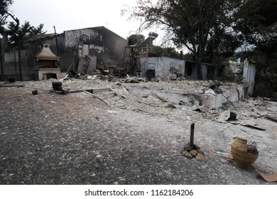 ATHENS, MATI / GREECE - JULY 25 2018: Α whole house burned out und disappeared in Mati near Athens after the fire-tragic