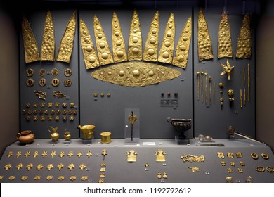 Athens - May 7, 2018: Gold jewelry from ancient Greek Mycenae. Golden crowns and other precious objects in the National Archaeological Museum in Athens, Greece.