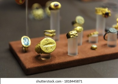 Athens - May 7, 2018: Gold jewelry in National Archaeological Museum of Athens, Greece. Ancient Greek golden decorations, precious artifacts of past civilization from archaeological excavations.