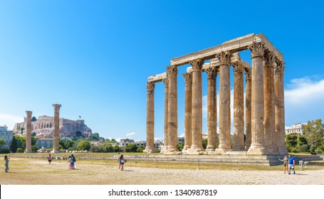 Athens – May 9, 2018: People visit the Temple of Olympian Zeus in Athens, Greece. Temple of Zeus or Olympieion is a great landmark of Athens. Panorama of huge Ancient Greek ruins in the Athens center.