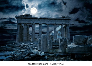 Athens at night, Greece. Mystic view of old mysterious Parthenon temple, top landmark of Athens. Ancient Greek ruins in full moon. Dark scene with haunted place for Halloween theme and history concept