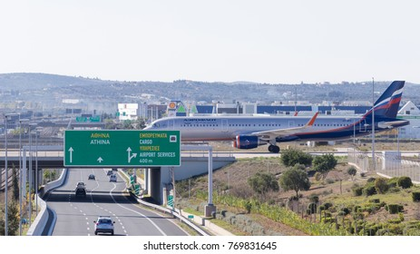 Athens - November 21, 2017: Large plane Boeing 737 5L9 company Aeroflot drives to the bridge, after a perfect landing, and connects to the airport of the city November 21, 2017, Athens, Greece