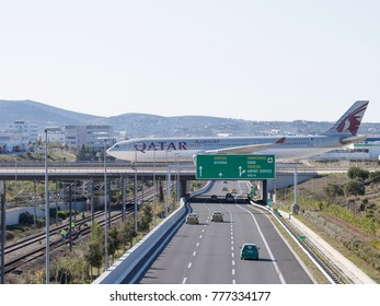 Athens - November 21, 2017: A powerful passenger airplane A-330-302 from Qatar Airways drives into the bridge, after a perfect landing, and cars under the bridge November 21, 2017, Athens, Greece