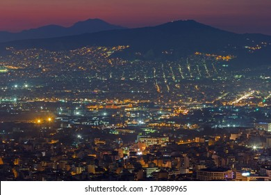 Athens skyline aerial view in the afternoon with the lights over at sunset or evening