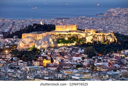 Athens skyline panorama with Acropolis in Greece from peak Lycabettus at night