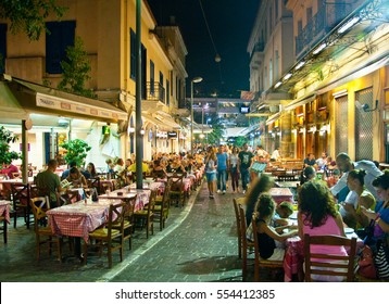 ATHENS-AUGUST 22: Street with various restaurants and bars on Plaka area, near to Monastiraki Square, locals and tourists enjoy their meal on August 22, 2014 in Athens, Greece.