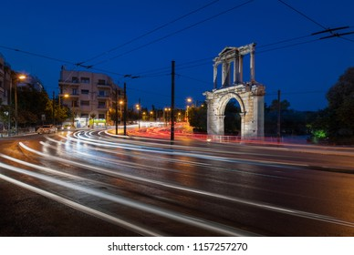 ATHENS,GREECE - 15 August 2018 : The Arch of Hadrian is a triumphal arch which lies in a walking distance from Syntagma square, right between the rock of the Acropolis and the temple of Olympian Zeus.