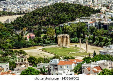 Athens.Greece.May 31, 2019. Panorama of Athens and the columns of the temple of  Zeus Olympian.