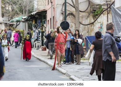 ATHENS,GREECE - MAR 09 : Greeks celebrating carnival with ancient traditional costumes, March 09, 2013 in Athens,Greece