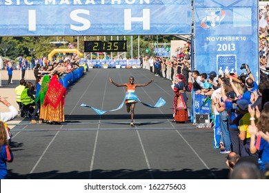 ATHENS,GREECE - NOV 10: 30th Athens Classic Marathon a hard race of 42,195 m. Kenya's Yego Hillary Kipkogei crosses first the finish line at the Panathenean stadium ,November 10, 2013 in Athens,Greece