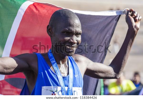ATHENS,GREECE - NOV 11: 30th Athens Classic Marathon a hard race of 42,195 m. Kenya's Raymond Kimutai Bett crosses first  the finish line at the Panathenean stadium November 11, 2012 in Athens,Greece