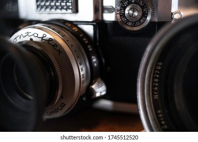 Athens/Greece/05,31,2020:The old Zeiss Ikon Contaflex camera photographed up close on a wooden desk with a lens beside it