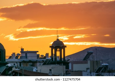 Athens,Greece-February 17,2018.Image shows a beautiful with orange sky over the city.