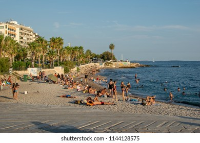 Athens,Greece-July 20,2018.People sunbathing and swimming at the beach of Palaio Faliro.