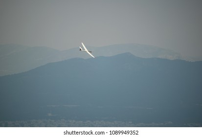 Athens,Greece-May,13 2018.Image shows a sailplane flying over the city.