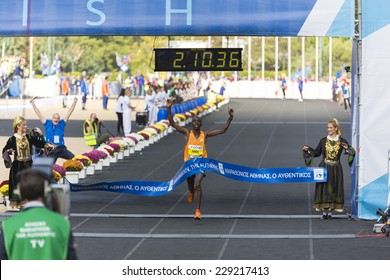 ATHENS,GREECE-NOV 9:32nd Athens Classic Marathon a hard race of 42,195 m. Felix Kipchirchir Kandie crosses the line to win at the Panathenean stadium ,November 9, 2014 in Athens,Greece