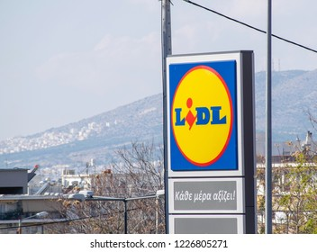 Athens,Greece-November 09,2018.Sign of a Lidl supermarket against a blue sky.