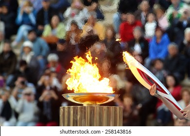 ATHENS,GREECE,OCT 5,2013:The Olympic flame was handed to organizers of the Sochi Winter Olympics 2014. The ceremony took place at the site of the first modern summer games, the Kallimarmaro Stadium