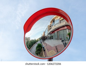 Athens,Greece-October 11,2018.Reflection of a street at a street mirror.Big Vodafone logo at a store.
