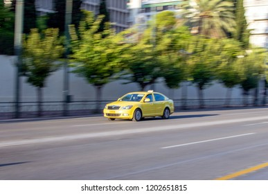 Athens,Greece-October 6,2018.Image shows a yellow Greek Athenian  Taxi photographed with the panning technique.