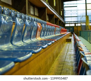 Athens,Greece-October 9,2018.Empty plastic seats of a small old stadium with wooden floor.