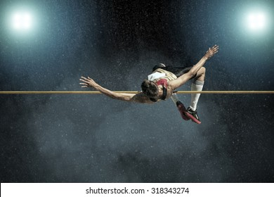 Athlete in action of high jump.